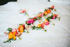 Boldly Hued Boutonnieres with Tags    Photography: Paige Jones   Read More:  http://www.insideweddings.com/weddings/lively-colorful-wedding-at-fairmont-miramar-hotel-bungalows/839/