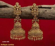 Beautiful antique jumkhis with lakshmi devi design. Jumkhis with peacock design. Gold Jhumka Earrings, Indian Jewelry Earrings, Gold Earrings Designs, India Jewelry, Antique Earrings, Bridal Jewelry, Antique Jewelry, Ear Earrings, Bridal Earrings