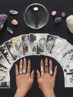 Witch Aesthetic: tarot cards, crystals & a crystal ball. Divination. Gemstone rings.