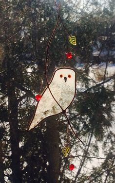 Hey, I found this really awesome Etsy listing at https://www.etsy.com/listing/163264955/snowy-owl-stained-glass-suncatcher