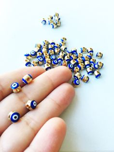 A personal favourite from my Etsy shop https://www.etsy.com/listing/462284764/5pcs-round-evil-eye-spacer-beads-6mm