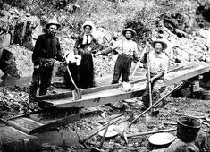 A woman with three men panning for gold during the California Gold Rush Ruée Vers L'or, Blockchain, Panning For Gold, Gold Miners, Woman In Gold, Into The West, Le Far West, Antique Photos, Vintage Pictures