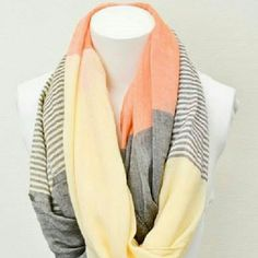 1efa039c832 Shelia Infinity Scarf A colored block infinity scarf detailed with bright  colors and striped accents that