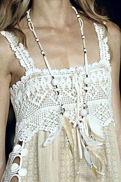 .great lace and macrame detailing on a white blouse...that necklace really pulls the outfit together
