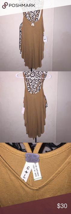NWT Free People Strap Back Top NWT Free People Strap Back Top. Size Large. Color is a brownish mustard yellow that looks great on! Size Large. In excellent no flaws. Reasonable offers only please and No Trades. Free People Tops Tank Tops