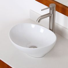 @Overstock - Elite High Temperature Grade A Ceramic Bathroom Sink with Oval Design and Brushed Nickel Finish Faucet Combo - Brand new technology and design from Europe brings a modern design style to the bathroom with this curved oval ceramic vessel bathroom sink. A gorgeous brushed nickel single-handle faucet is ...