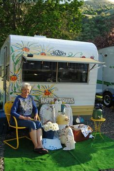Vintage camper - this is too cute! I just want to give her a hug, and I love the flowers painted on the camper