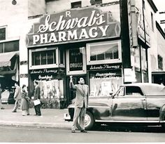 "Pictured here in front of Schwab's Pharmacy on Sunset Blvd is Sidney Skolsky who was a gossip columnist who wrote for several New York newspapers and had a column in Photoplay magazine called ""From A Stool At Schwab's"" because that's where he wrote his articles. Imagine using Schwab's as an office! With that hubbub and bustle, I don't know how the got a thing done. Skolsky is now probably best remembered for his close friendship and undying support of Marilyn Monroe. Skolsky is thumbing for…"