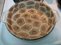 Use 2 cans of cinnamon rolls. Press into pie plate, fill with favorite pie filling. Bake. Yum