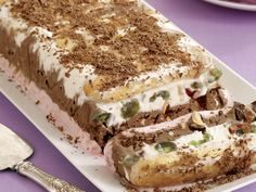 Studded with red and green glace cherries and topped with nuts, this tri-flavoured Ice-cream cassata log by recipes+ is the perfect make-ahead dessert for any family special occasion.