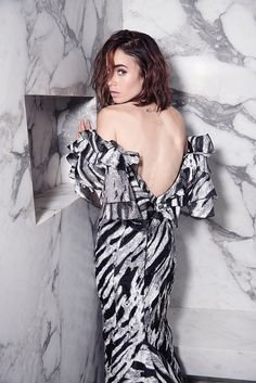 Showing her back, Lily Collins wears Christian Siriano dress for Malibu Magazine November 2016 Issue