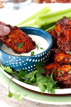 Sticky Buffalo Honey Hot Wings coated in a flavorful rub then smothered in a perfect marriage of honey, molasses and Hot Wings Sauce. I've also included a recipe for the BEST traditional Hot Wings.