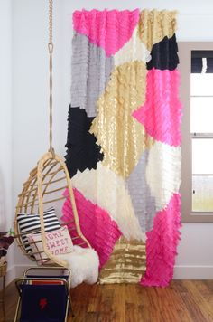 Love the rattan swing and those curtains are so much fun for a girls room!