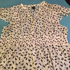 Cap sleeve butterfly tunic Sheer white tunic with whimsical black butterflies. Elastic band and peplum bottom. Buttons up the top. Like new. Torrid size 3. torrid Tops Tunics
