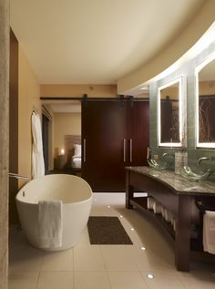 powder room, oversized soaking tub, duel glass vanity's, spa inspired shower, water closet