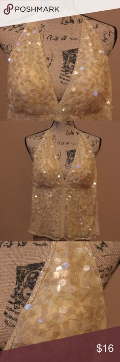 Venus Beaded Low Cut Halter Venus Beaded low Cut Halter.  Stunning Cream Beaded Top.  Perfect with Jeans and booties or pair with leggings or leather skirt and heels.  Timeless piece for any wardrobe. VENUS Tops