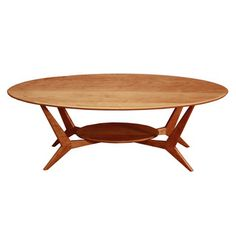 @Overstock   Wood Revival Mid Century Coffee Table   An Oval Shaped Design  Gives