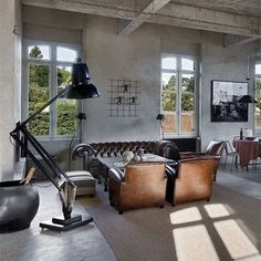 The Giant 1227 Floor Lamp, obviously a huge and exaggerated, very cool. Designed by George Carwardine.