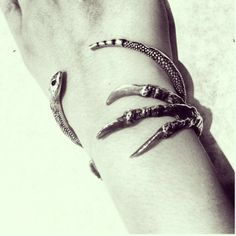 Two of my favorite bangles of all time by Pamela Love. The Serpent Bangle and The Talon Cuff.
