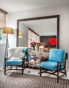 Dilemma: Room feels cramped.   Try this: Add a giant mirror. Your space may be small, but it doesn't need to feel that way! The biggest impact design move you can make in a small space is to add a really big mirror. Hang it or just lean it against the wall, and your space will immediately feel much larger.