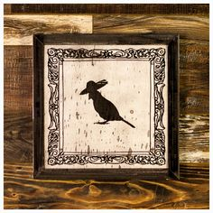 """Lucia    Thegrand dame of the aviary world...    Lucia is Made-To-Order and is available in a Silver or Gold finish    Lucia is madefrom poplerthat has been burnt completely black using a Japanees technique calledShou Sugi Banand then painted. The image is revealedby ripping away the pigment, leaving the texture of the burnt wood underneath.    The frame is welded 1-1/4"""" steel angle, with a light grinding, for a very industrial feel.    As each piece of poplerburns with a unique…"""