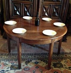 Rare large Directoire table that folds to become a demi lune in exceptional French walnut.