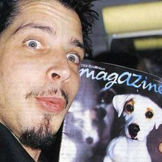 Chris Cornell making a funny face with a puppy magazine. Chris love's dogs, btw, just fyi.