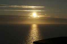 Sunset over Cardigan Bay cliff top