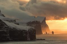 The Faroe Islands is a special place, as depicted in this imposing photograph. Photographer Alessio Mesiano comes here in the winter - an incredibly dangerous time of year due to the combination of snow and very steep cliffs. Nature Photos