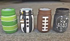 I was inspired by another Pinterest user. First time painting mason jars and I think I did a pretty good job. I used these as utensil holders.  DIY instructions are found here:  http://masonjarcraftslove.com/football-party-mason-jars/