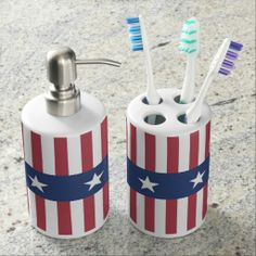 A patriotic bathroom set with toothbrush holder and soap dispenser with a stars and stripes design in red, blue and white.