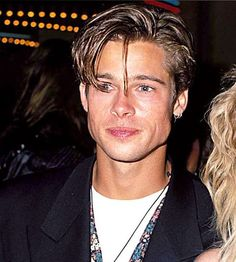 This is a picture of Brad Pitt during the 90's. Hairstyles for men changed too. they would go for the messy long look. they would normally part their hair in the centre.