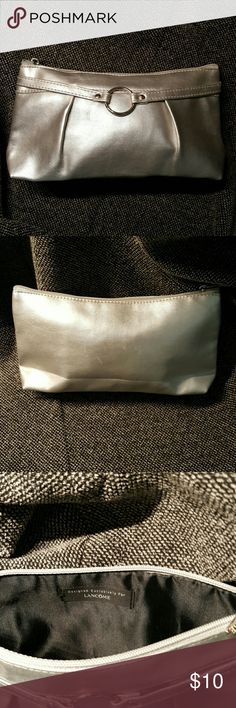 Silver Lancome Makeup bag / Handbag PERFECT makeup bag or handbag! Fits your favorite makeup and cell phone. BRAND new never used. 9 inches long 4 inches high and 2 inches wide. Lancome Bags Cosmetic Bags & Cases