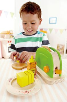 Hape - Playfully Delicious - Pop-Up Toaster - Play Set.  Making toast is easy with this double-slice toaster. A pat of butter and a dab of honey to finish the job. (Amazon - Toys & Gifts)