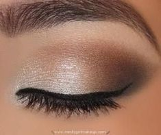 Shimmery gold and brown smokey eye makeup. I think this is close to what we talked about, right?