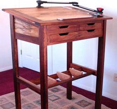 Stand-Up Desk and Drafting Table.  Minus the drafting equipment this is pretty nice...need a bar on the bottom.