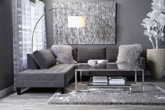 monochrome shades of grey interior design. apartment condo small living room grey walls light grey wood floors. grey sectional couch