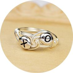 XO Hugs and Kisses Sterling Silver Filled Wire Wrapped Ring- Any Size- Size 4, 5, 6, 7, 8, 9, 10, 11, 12, 13, 14 by SimplyCharmed21 on Etsy https://www.etsy.com/listing/161089391/xo-hugs-and-kisses-sterling-silver