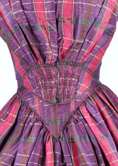 A tartan taffeta gown with day and evening bodices, late 1840s-early 1850s. the evening bodice with short sleeves now attached to the skirt, the day bodice with shirring to waist and pagoda sleeves, bust approx 86cm, 34in; together with a chocolate brown damask day dress, early 1840s (3). - See more at: http://kerrytaylorauctions.com/one-item/?id=208&sub=%20&auctionid=402#sthash.xns5GTyj.dpuf
