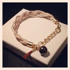 Bracelet with a mini tassel and a magnetyte bead.