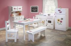 Carefully built to endure years of fun, our Amish Handmade Children's Kitchen Play Set offers a table, pantry, refrigerator, and kitchen accessories.