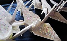 1000 Origami Paper Cranes with Glitter These are white paper cranes coated with sparkly glitter. They can be shipped with opened wings, or closed wings and are ready for the party <3 I have other quantities and various sizes available. :)