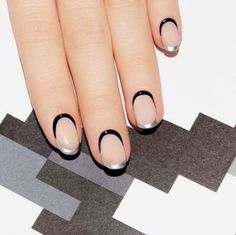 13 best summer nail art ideas: Metallic frame of mind; try something simple and chic by framing each nail in half metallic half black.
