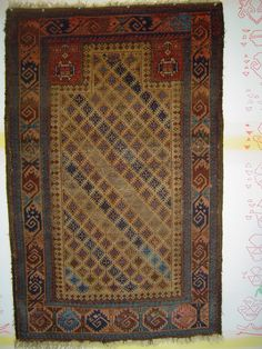 "Singular Baluch prayer rug, with 159 snowflake stars in a staggered repeat on the camel field. 34 x 54 inches. Each star contains a small ""cross le-boutonnee"". Dramatic use of a sizzling  ..."
