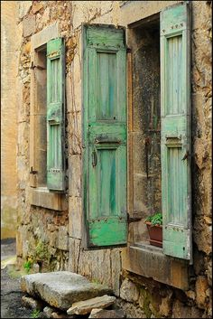 Distressed A stately ornate ancestral home should have that match it even if those shutters are brand-new. Protect your home with shutters that are durable, but also make a statement with distressed shutters with crackled paint to give an old-world flair. French Country House, French Farmhouse, Old Windows, Windows And Doors, Green Windows, Vintage Windows, Green Shutters, Exterior Shutters, Through The Window