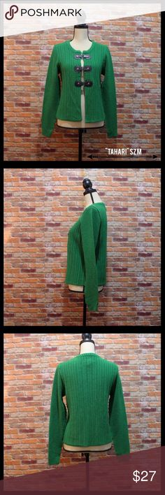 "Tahari Merino Wool Blend Cardigan W/Buckle Closure Tahari merino wool blend cardigan in a size medium.  Three buckle snap clasps in the front for closure.  Beautiful emerald green color.  Measures approximately 19"" from armpit to armpit and 22"" in length.  50% Merino wool and 50% acrylic.  In excellent condition. Tahari Sweaters Cardigans"