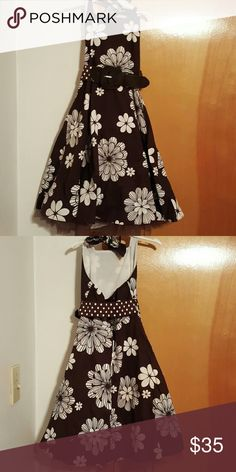 Beautiful girls dress Must have! Brown dress with white flowers, belt, low back, halter tie, and ruffle under skirt. Never worn Rare Editions Dresses Formal