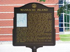 Massacre Island historical marker located at the Baudette Wayside/Peace Park in Baudette, Minnesota at the Canadian border crossing. The marker tells the story of the murder of Jean-Baptiste La Verendrye, Father Pierre Aulneau and 19 voyageurs by a Sioux war party on a small rocky island in Lake of the Woods. It was erected by the Minnesota Historic Sites and Markers Commission in 1966.