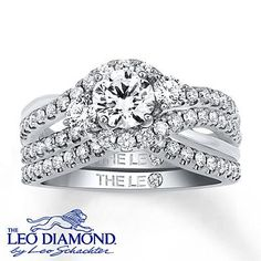 Diamonds curve around this magnificent round Leo Diamond to create a beautiful bridal set.
