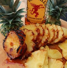 Whiskey Pineapple Recipe - Pineapple Soaked in Fireball Whiskey, Rubbed with Sugars and Grilled on Rotisserie.Fireball Whiskey Pineapple Recipe - Pineapple Soaked in Fireball Whiskey, Rubbed with Sugars and Grilled on Rotisserie. Pineapple Recipes, Fruit Recipes, Appetizer Recipes, Grilled Pineapple Recipe, Grilled Fruit, How To Grill Pineapple, Bbq Pineapple, Eating Pineapple, Side Dishes